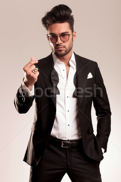 Handsome young business man standing on studio background Stock photo © feedough