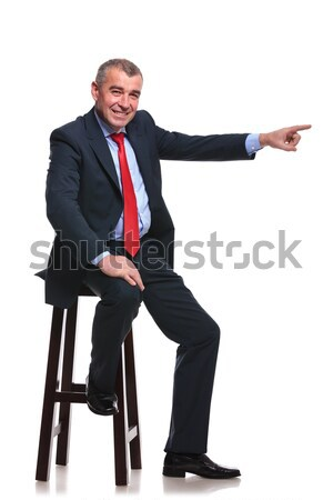 young happy business man sitting on chair and welcoming you Stock photo © feedough