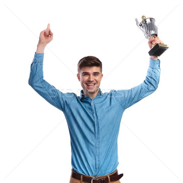 Férfi ünnepel siker tart trófea csésze Stock fotó © feedough