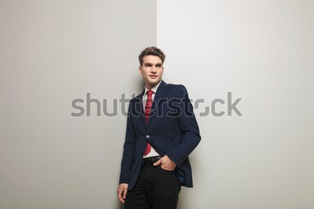 smart casual man with hand in pocket pointing finger Stock photo © feedough