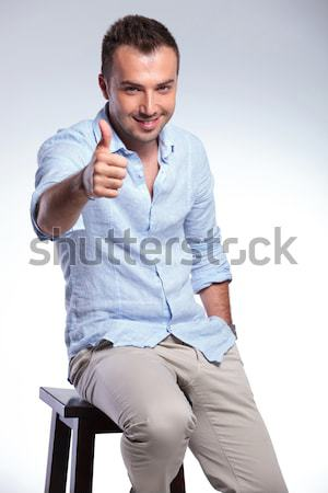 portrait of seated smart casual man looking to side Stock photo © feedough