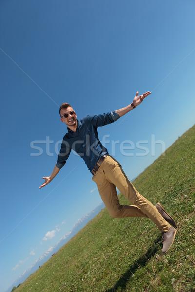 outdoor casual man raising his shoulders Stock photo © feedough