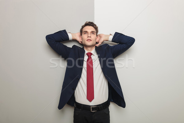 Young business man holding both hand to his head  Stock photo © feedough