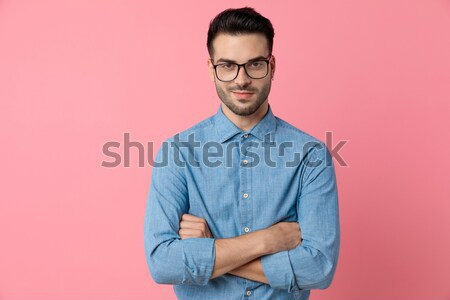 young man smiling and touching his chin Stock photo © feedough