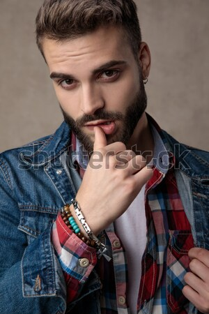 serious fashion man holding chin in his hand, thinking Stock photo © feedough