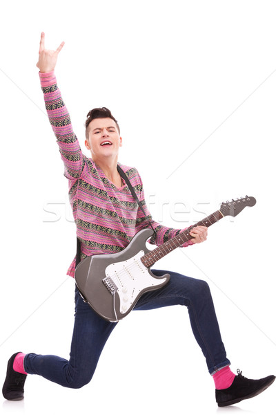excited rock star with an electric guitar Stock photo © feedough
