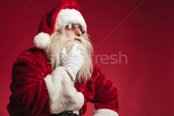 Pensativo papá noel tocar barba barbilla Foto stock © feedough