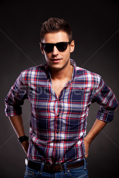 young casual model wearing sunglasses,facing the camera Stock photo © feedough