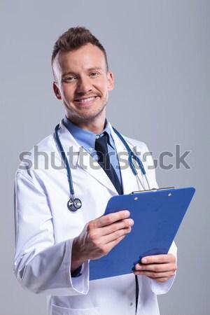 Сток-фото: старые · врач · блокнот · улыбаясь