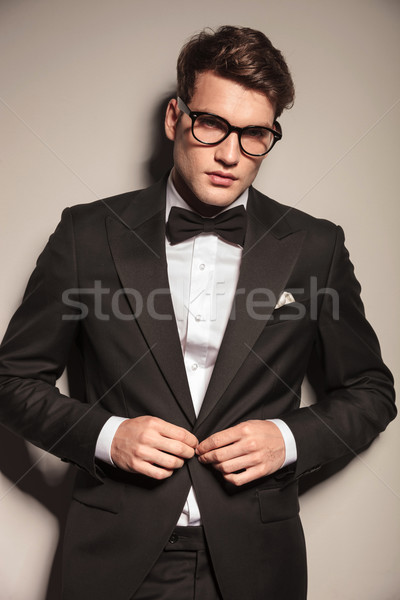 Young elegant business man closing his jacket  Stock photo © feedough