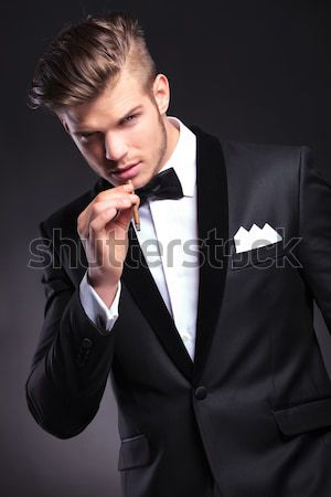 portrait of seductive businessman leaning to side while thinking Stock photo © feedough