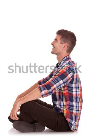 young man sitting with hands on knees Stock photo © feedough