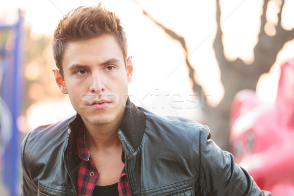 Young casual man  with leather jacket Stock photo © feedough