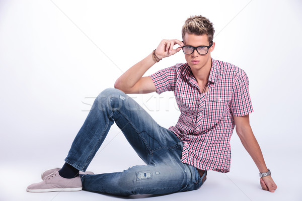casual man sits & adjust specs Stock photo © feedough