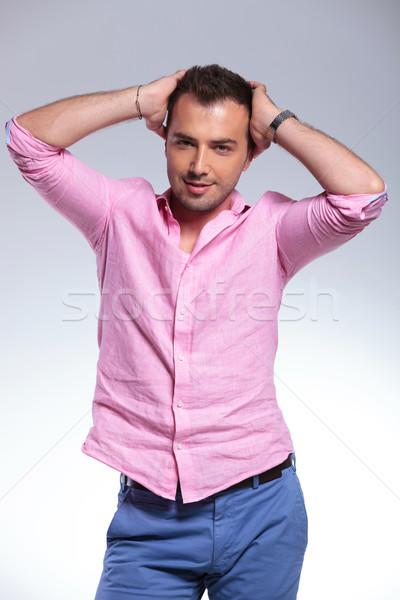 Lezser férfi pózol mindkettő kezek fej Stock fotó © feedough
