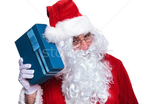 Święty mikołaj słuchania szkatułce odgadnąć co człowiek Zdjęcia stock © feedough