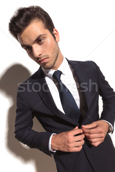 cool fashion business man closing his suit Stock photo © feedough