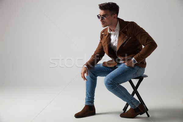 side view of a seated fashion model wearing sunglasses  Stock photo © feedough