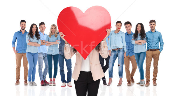 businesswoman group leader holds valentine's day heart in front Stock photo © feedough