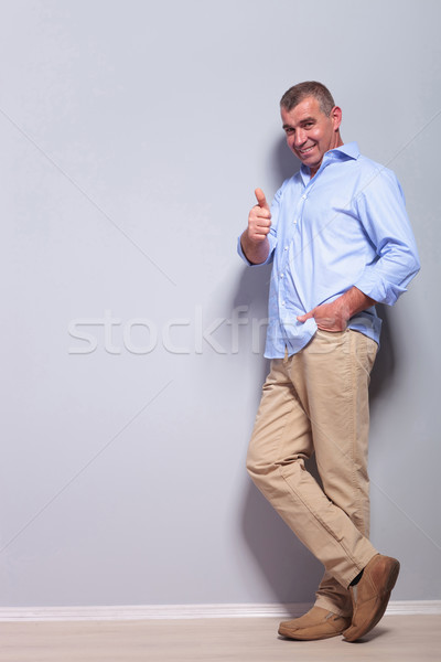 casual old man showing thumbs up to you Stock photo © feedough