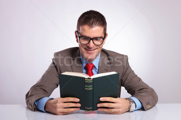 Stock photo: young business man holds book with both hands
