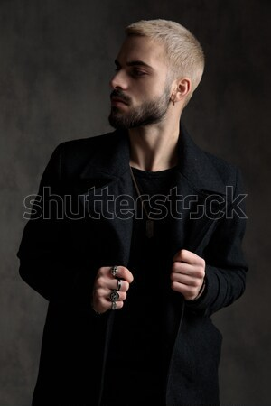 young fashion man looks over his shoulder Stock photo © feedough