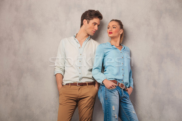 man standing with hands in pockets in studio stares at woman Stock photo © feedough