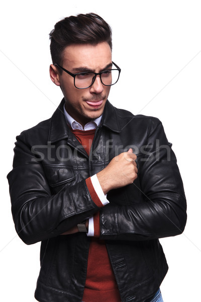 side of a casual man thinking and sticking out tongue Stock photo © feedough