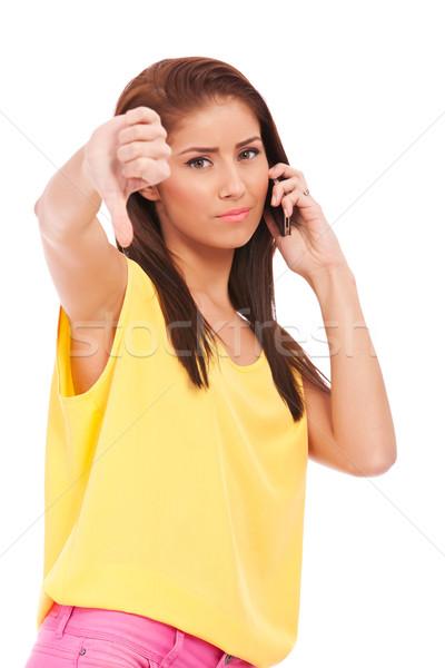 thumb down on the phone Stock photo © feedough