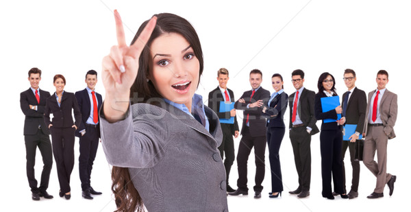 Succesful business woman and her victorious team Stock photo © feedough