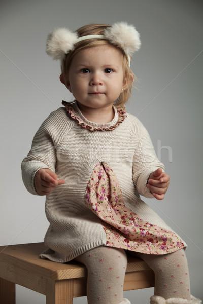 ülő kislány visel szőr medve fülek Stock fotó © feedough