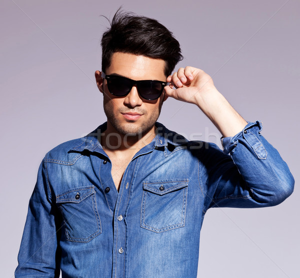 man holding his fashionable sunglasses  Stock photo © feedough