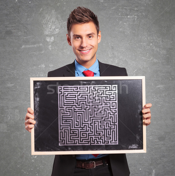 man holding a blackboard with a drawn maze Stock photo © feedough