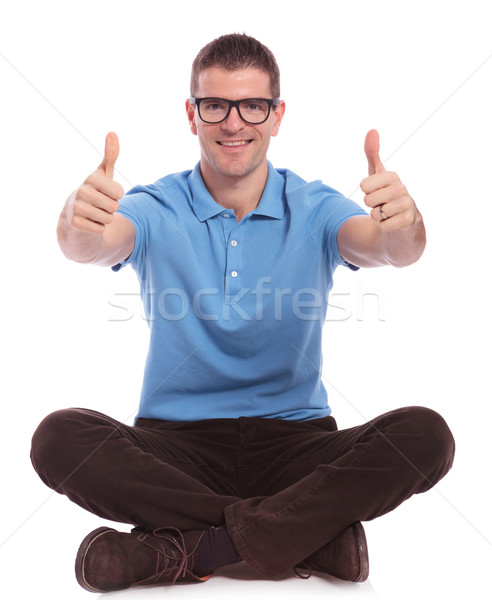 seated casual man with both thumbs up Stock photo © feedough
