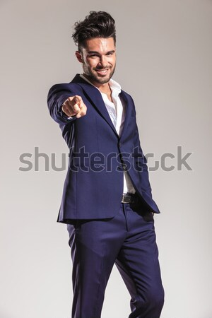 Handsome business closing his suit Stock photo © feedough