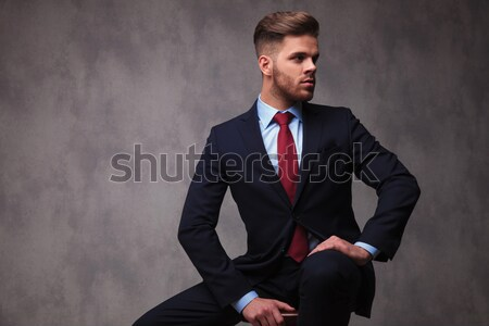 Attractive young man looking down  Stock photo © feedough