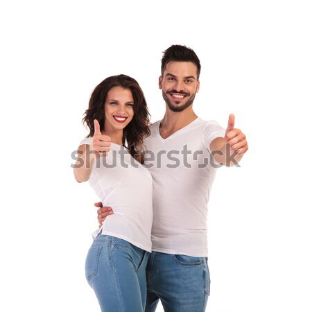 happy young casual couple making ok sign Stock photo © feedough