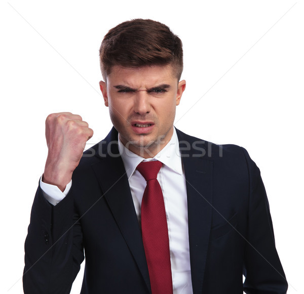 portrait of angry businessman shaking his fist in the air Stock photo © feedough