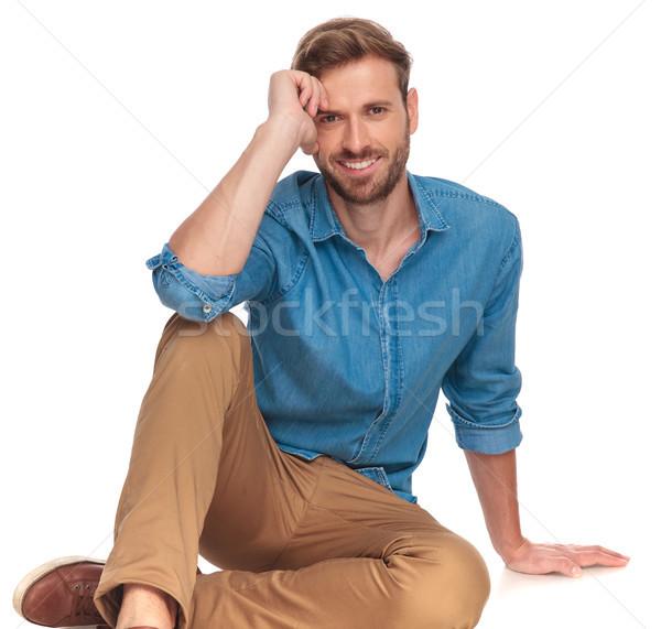 laughing young casual man lying down  Stock photo © feedough