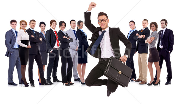 Stock fotó: üzletember · tart · aktatáska · ugrik · csapat · üzleti · csapat