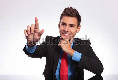 business man touches imaginary button Stock photo © feedough