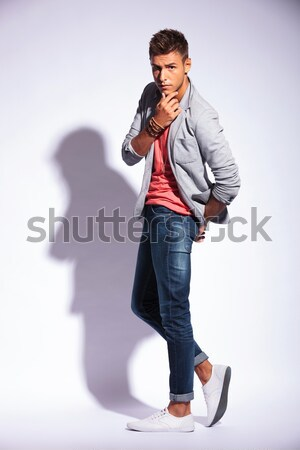 Stock photo: full length of casual man acting drunk