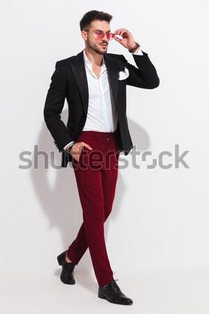 fashion man in tuxedo snapping his finger  Stock photo © feedough