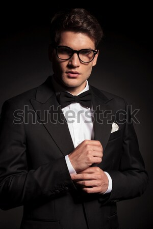 Elegant business man closing his jacket Stock photo © feedough