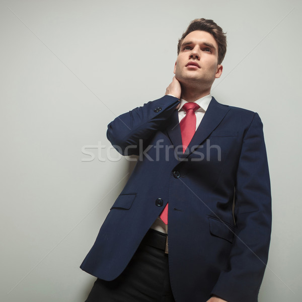 Concerned business man looking away  Stock photo © feedough