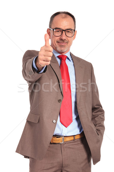 smiling old businessman making the ok thumbs up hand sign Stock photo © feedough
