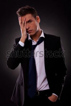 heartbroken groom in tuxedo with undone bowtie and open collar  Stock photo © feedough