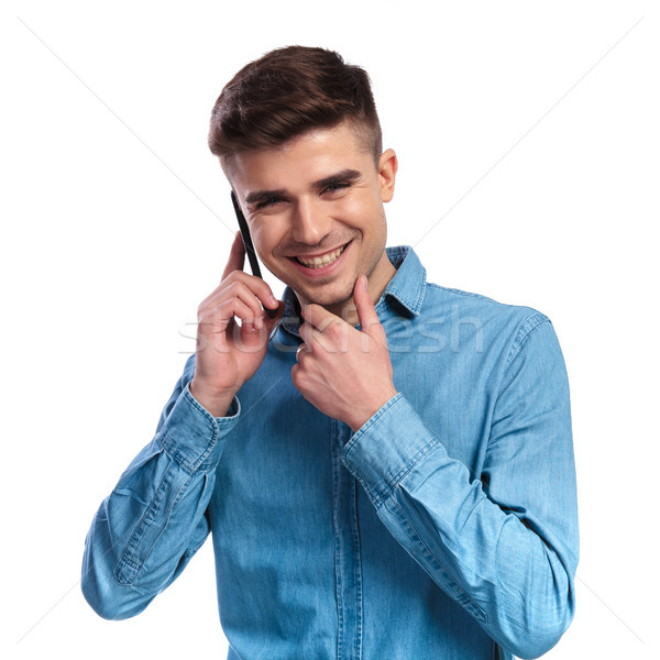 smiling casual man talking on the phone is thinking Stock photo © feedough