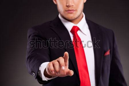 portrait of sexy businessman buttoning his suit jacket Stock photo © feedough