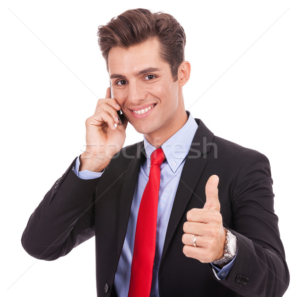 business man talking on the smart phone and making ok  Stock photo © feedough